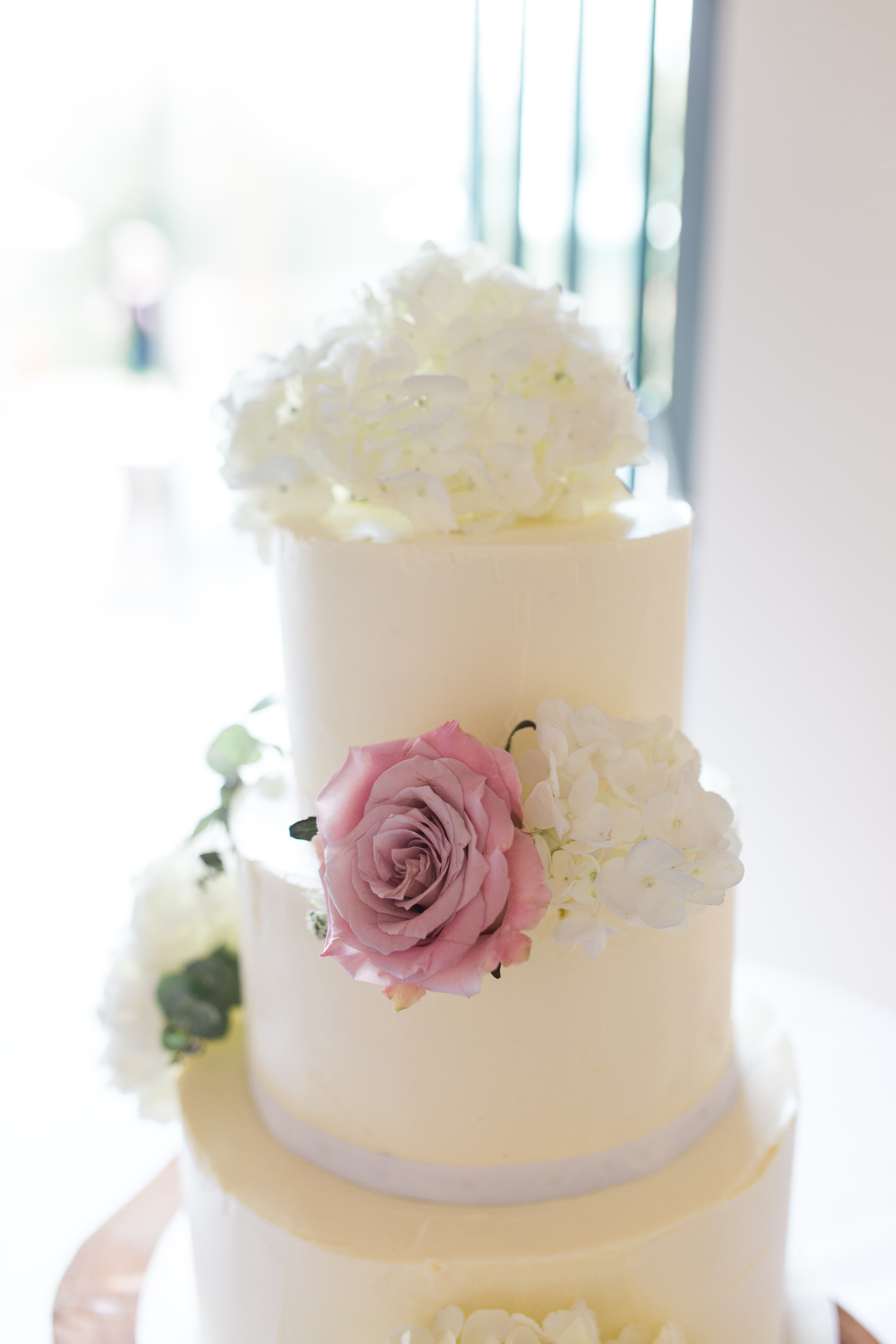 Buttercream wedding cake with fresh flowers